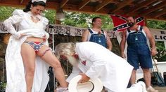 Let's have a look, here. Confederate flag, overalls, Col. Sanders, completely inappropriate skin showing, bride has father's head between her thighs...  Yup. All the elements of being completely redneck.