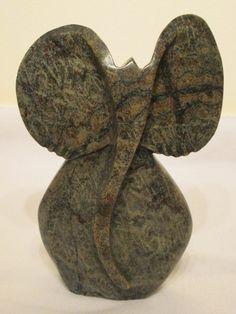 Abstract , stone Elephant sculpture done by Zimbabwean Shona artist in serpentine stone. Weight: 15 lb or kg Height in or 27 cm Width in or 17 cm Material: Serpentine stone African Masks, African Art, Animal Key Rings, Elephant Sculpture, Beaded Animals, African Animals, Wire Art, Stone Art, Animal Paintings