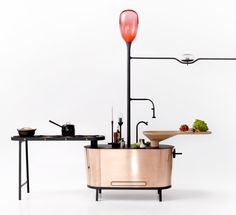 Philips Design: Bio-digester kitchen island that would break down solid bathroom waste and vegetable peelings into methane, while plastic packaging would be broken down by fungus.