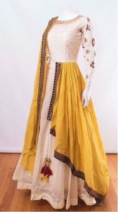 Like the white anarkali and yellow dupatta combo. Don't wanna get it sew though Indian Gowns Dresses, Indian Fashion Dresses, Dress Indian Style, Indian Designer Outfits, Pakistani Dresses, Indian Outfits, Ivory Prom Dresses, Indian Clothes, Designer Party Wear Dresses