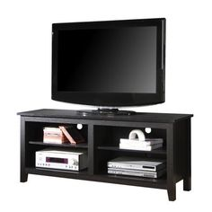 WE Furniture 58-Inch Wood TV Console, Black by WE Furniture. $129.00. Contemporary wood tv console accommodates most flat-panel tv's up to 60-inch.. High-grade mdf and durable laminate construction in rich, black textured finish. Adjustable shelving. Assembly instructions included with toll-free number and online support. Ships ready-to-assemble with necessary hardware and tools. Amazon.com                     Walker Edison 58 Inch Wood TV Console, Black  Style and fu...