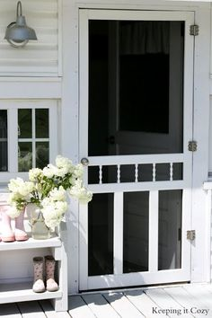 Though simple and somewhat plain, this white screen door exudes country charm.