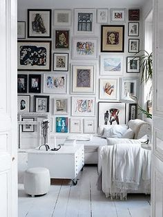 Floor to ceiling gallery wall - love a photo wall with mismatched frame styles and sizes