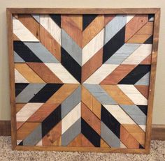 Starburst reclaimed wood wall art. Black and silver. Check it out!