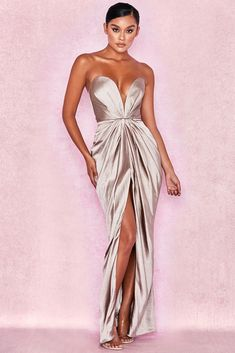 c2e657b7ddd Super feminine drapes and stand out cuts make  Sigourney  one show stopping  dress. Crafted from a lustrous rich satin