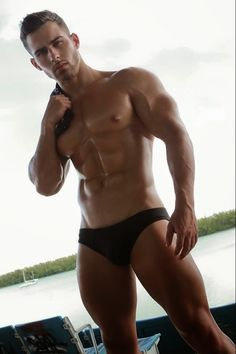 HOT MUSCLESTUD CRUISING BY THE SHORE ….WOOF ! BRING IT !