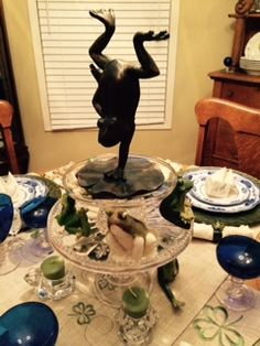 """At first I wanted """"elegant"""" frogs for the centerpiece, but then I decided they should be silly -- for only a fool will not listen when God commands.   Display is made on two stacking antique cake stands."""