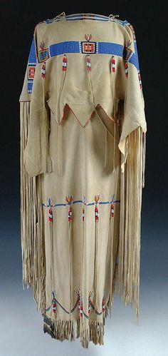 A VERY FINE LADIES CHEYENNE BEADED BUCKSKIN DRESS, c.1960.