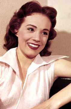 Julie Andrews.  SO young here!