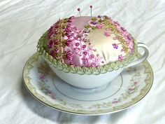 Teacup pincushion  by Susie W, via Flickr
