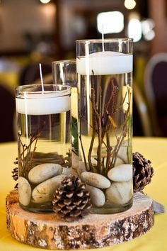 rustic winter pinecones wedding centerpiece with the candles / www. rustic winter pinecones wedding centerpiece with the candles / www. Wedding Table Flowers, Rustic Wedding Centerpieces, Wedding Table Centerpieces, Table Decorations, Centerpiece Ideas, Wedding Rustic, Pinecone Centerpiece, Christmas Centerpieces, Centerpiece Flowers