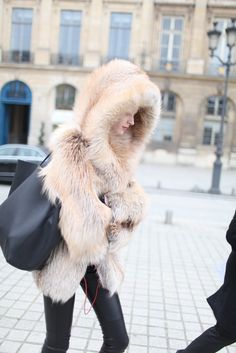 Paris Fashion Week street style. This looks amazing. I can't help but to love beautiful fur coats.