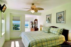 Key lime green walls and a king size bed with green and yellow plaid bedspread, this suite commands water views on two sides and offers a full en-suite bathroom. Private Key West Sunset | 3 Bedroom Nightly Vacation Rental