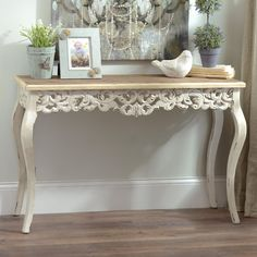 Add a simple, chic piece to your entryway to brighten the mood of your home. Our Ivory Baroque Console Table is subtly elegant. Its natural wood-finished tabletop gives this piece a rustic vibe while the ornate carvings make it delicately feminine. Entryway Decor, Entryway Tables, Hall Tables, French Console Table, Antique Console Table, Affordable Furniture, Bars For Home, Living Room Furniture, Painted Furniture