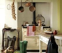 Well if this isn't meant to be my kitchen I don't know what is! Rain boots, old stove, I bet there's a farm right out that door! Ahh