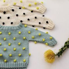 polka dotted, textured handmade sweaters, the best! kalinka kids #estella #kids #hand #knit #designer