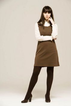 Felicity Jones in brown wool pantyhose and dress with white shirt underneath