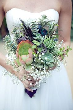 Succulent bouquet with peacock feathers & navy/indigo accents. Love!