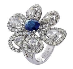 Avakian flower ring, set with a 2ct sapphire and rose-cut and round diamonds totalling 6ct.