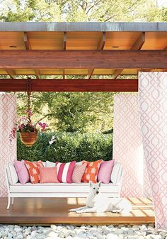 Thibaut- Love this gazebo idea for a back yard and the bright colored pillows