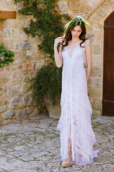Ethereal + modern wedding dress idea - V-neck gown with soft lace tiers and a slit in the front- loose curls and greenery headband {Elias Kordelakos Photography} Top Wedding Dress Designers, Wedding Dress Trends, Wedding Dress Shopping, Greek Wedding Dresses, Wedding Dress Sleeves, Wedding Gowns, Wedding Attire, Bridal Gowns, Bridal Musings