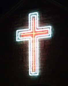 Neon crucifix outside a church in Ashland, KY by josephleenovak, via Flickr.