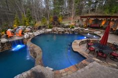 Amazing pool and patio design in this gorgeous backyard