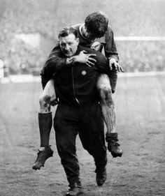 Liverpool trainer Bob Paisley carries off fullback Emlyn Hughes. April, 1968