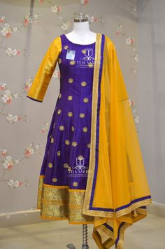TS-DS- 554.Available. Beautiful purple and yellow color combination floor length anarkali dress with pattu boarder. For orders/queriesCall/ whats app on8341382382 Mail  tejasarees@yahoo.com. 07 March 2018 Anarkali Dress Pattern, Salwar Dress, Sari Dress, Anarkali Patterns, Kalamkari Dresses, Ikkat Dresses, Patiala Suit Designs, Salwar Designs, Dress Neck Designs