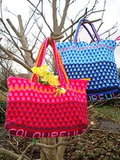 Crocheted colourful city bag. It's closed with a zip. On the bottom of the bag the word 'colourful' can be embroidered to make it look extra special.