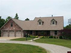 All brick built in 2007 4BR/3BA split floor plan. Main level: bedroom, bath, family room, game room & 3 storage rooms in basement. Double hung Anderson windows. Whole house generator. Geo thermal HVAC. Storm shelter under front porch. 30x50 insulated outbuilding w/ 1/2 bath & HVAC, 12x12 overhead door & opener plus sliding side door. RV parking w/electric & septic hookups. Fenced & cross fenced partial pasture. 2 ponds. Automatic watering for 3 donkeys in Midway AR