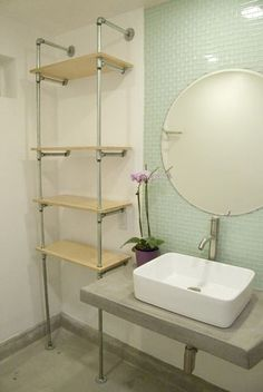DIY Plumbing Pipe Shelf for bathroom from re-nest. http://www.re-nest.com/re-nest/howto-build-your-own-ace-hotelinspired-plumbing-pipe-shelf-128723