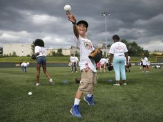 Preston Jacobs, 12, of Lawrenceburg, Ind., participates an attempt to break the world record for the largest game of catch in Cincinnati, OH.  Kareem Elgazzar, The Cincinnati Enquirer
