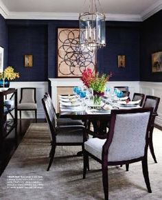 navy grasscloth on the walls with crisp white trims, brass light fittings, stunning dark wood floors and a silk carpet underfoot by penelope