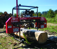 "30"" log capacity, 2 - 7' track sections, 13 HP gas engine. Centrifugal clutch, 1.5"" band wheel bearings, 19"" band wheels, hand winch lift system, dual measuring system with quarter scale and standard inches or metric, dual Hud-Son guide system with adjustable guide, two standard log dogs and squaring back stops, 1.25"" Hud- Son band blades, blade lubrication system, optional extra length track sections"