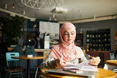 Muslim woman reading in cafe Stock Photo by seventyfourimages   PhotoDune Woman Reading, Muslim Women, Business Women, Stock Photos, Female, Pretty, Fashion, Moda, Fashion Styles
