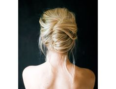 @Byrdie Beauty - We're obsessed with this stunning, low-key take on the classic French twist.