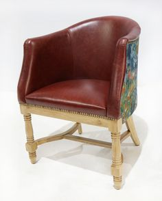 This is a classically designed tub chair manufactured in oak.