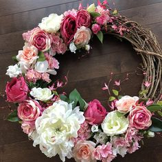 Pretty in pink describes this wreath perfectly! Featuring spring blooms in contrast with a partially filled grapevine base. It shows a monochromatic play on pink while creating texture and depth. The purchase of this listing is for a spring wreath with the following details: