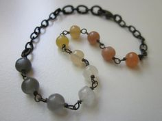 Moonshot - dreamy pale soft peach, white, and gray moonstone polished round gemstones and antiqued black brass simple linear modern bracelet by LoveRoot, $28.00