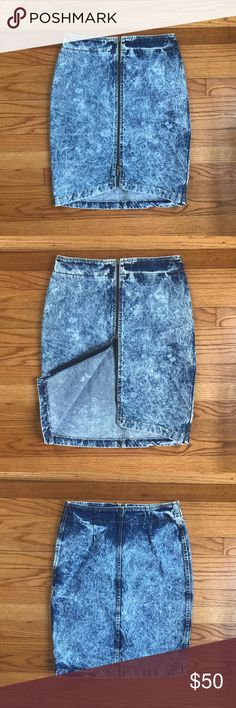 "High Waisted Vintage Denim Skirt Vintage denim skirt in acid wash blue. Excellent condition! Zipper closure. Fits like a 4.  14.5"" across at waist, 18.5"" across at hips, 22.5"" long Vintage Skirts"