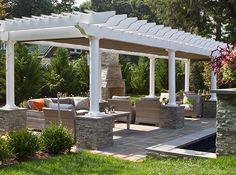 Mierop Design installed two retractable shades on a pergola covered seating area to provide protection for their newly designed and built outdoor space