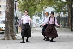 These three girls were dancing down the sidewalk in the Hasidic section of Williamsburg.