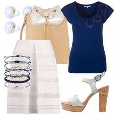 Outfit vagamente anni '50 e bon ton in toni chiari e neutri con un tocco di blu elettrico. Ottimo per un giro in centro, una cena fuori, ma anche al lavoro se l'ambiente non richiede di essere troppo formali.