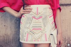 White miniskirt with gorgeous gold, silver, and hot pink studded detailing.