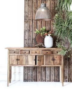 Rustic chic furniture full of wooden texture. Great living room piece to add a touch of charm to your home interior.