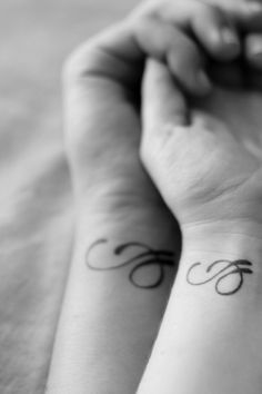 Couples tattoo. The design is the first letters of their names intertwined (e and j).