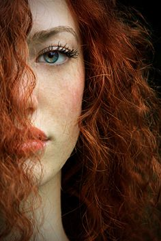 """She was a woman with red hair and green eyes - the traits which Satan supposedly relished most in mortal females."" - Robert Shea, ""The Eye in the Pyramid"" 