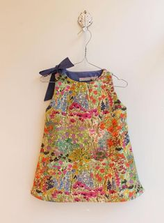 Lovely wild-flower print dress an warm mustard, dark pink and light turquoise blue, with navy contrast ribbon tie and lining. @pigve