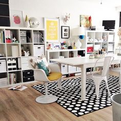 Love this work space...black, white, wood floor and pops of color, plus I really love that black and white rug.